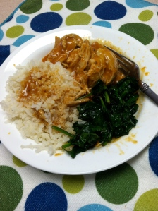 "Chicken with cauliflower ""rice"" and sauteed spinach."