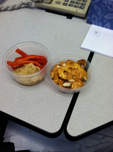 Pepper strips, hummus and pretzel crisps.