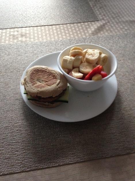 Veggie burger with fruit salad